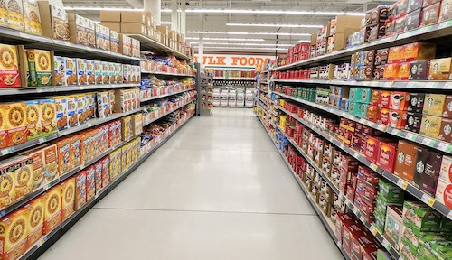 Photo inside of a Supermarket, with many products on the shelfs