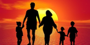 Silhouettes of a Family, and a sunset as background